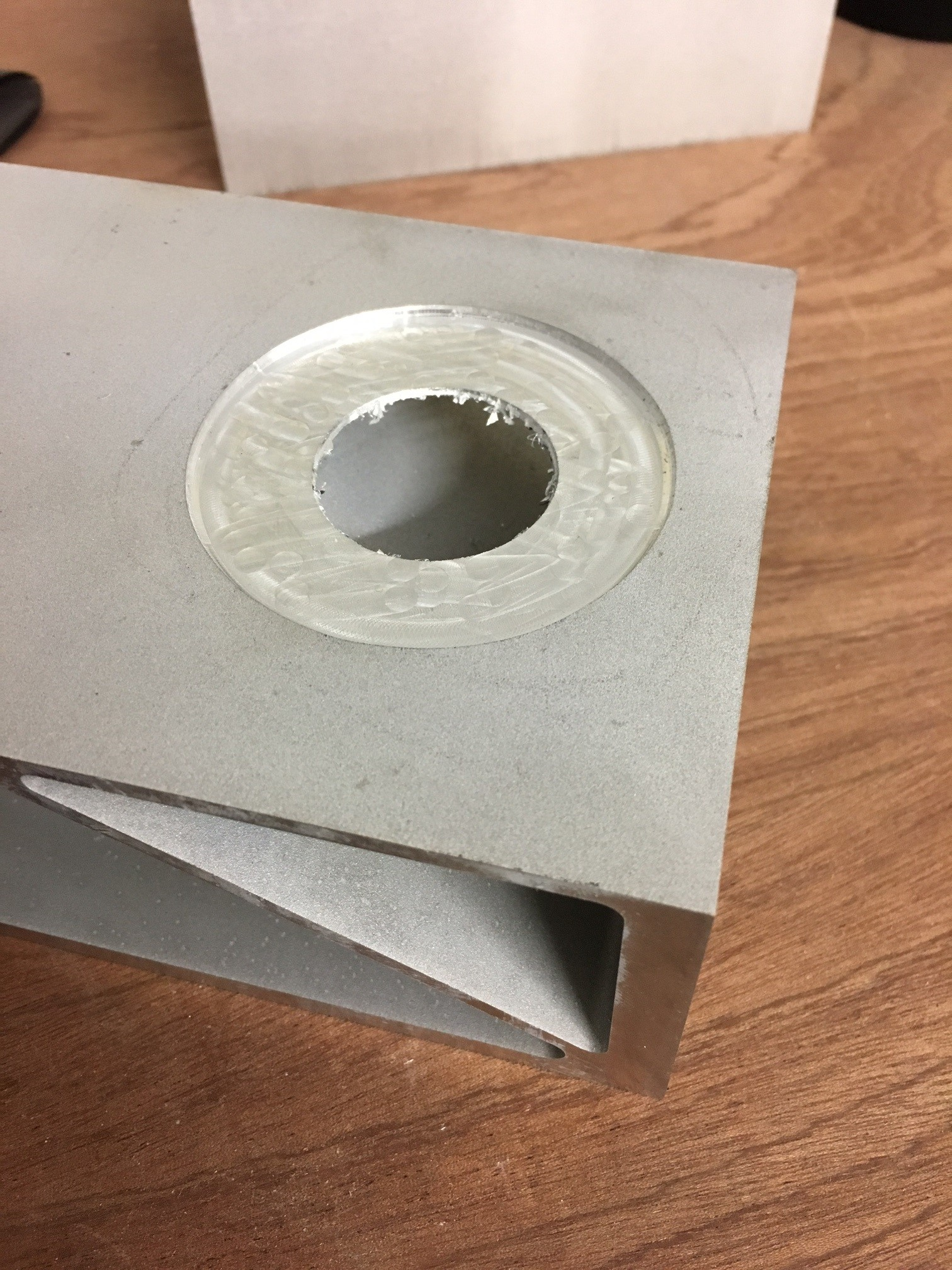 Large, round, stepped hole in sample workpiece